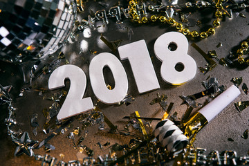 New Year: Looking Down At 2018 NUmbers WIth Noisemaker And Disco Ball