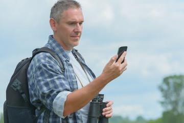 Backpacker using smart phone