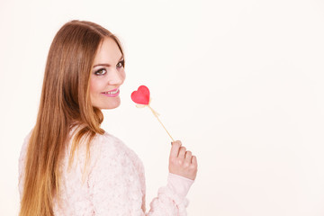 Beautiful woman holding heart shaped hand stick