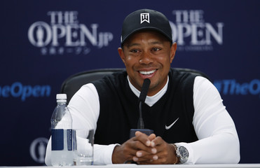 Woods of the U.S. smiles during a news conference ahead of the British Open golf championship on the Old Course in St. Andrews, Scotland