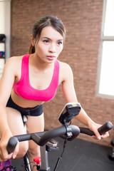 woman use gym flywheel