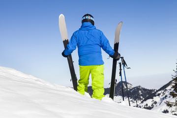 Ski holiday, Skier on mountain peak, Sudelfeld, Bavaria, Germany