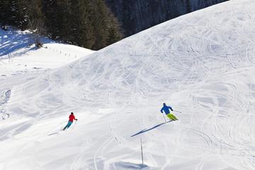 Ski holiday, Skiers carving downhill, Sudelfeld, Bavaria, Germany