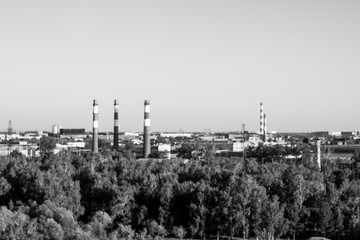 Black and white shot of the landscape of the Siberian city, made from the height of the attraction in the park