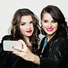 Happy Girls Friends with Cell Phone Smiling and Taking Selfie