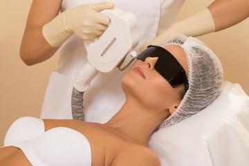 Woman during photoepilation procedure