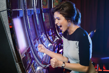 Woman is happy of her win in slot machines