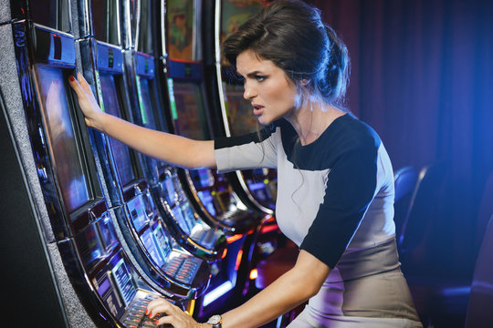 Woman is losing during slot machines game