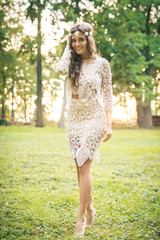 Beautiful woman wearing lace dress and circlet of flowers