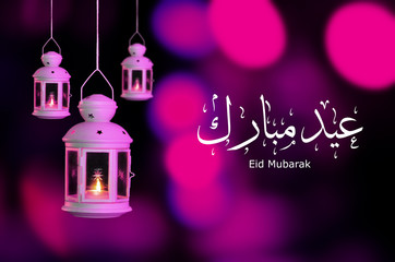 Eid Mubarak with night lights. festival mood at night with light decoration in the Purple background