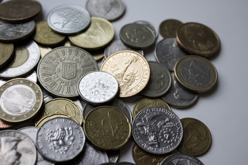 A beautiful image of different coins under natural light. Can be used as a greeting card