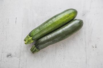 Zucchini. Fresh zucchini on white concrete board