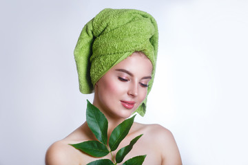 young beautiful woman with a green towel on her head