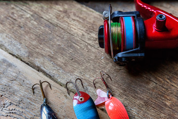 fishing tackle on a wooden surface