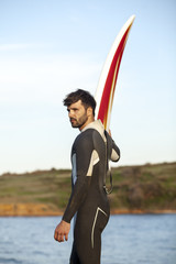 Male surfer with surfboard