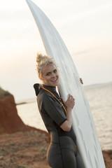 Female surfer on beach
