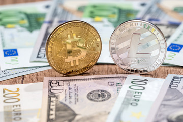 Litecoin and bitcoin with dollar and euro bills. business concept