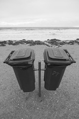 Trash cans on a beach