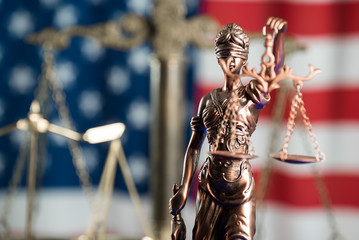Law symbols on USA flag background.
