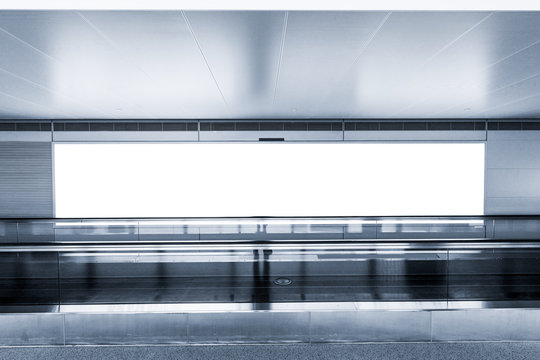 empty billboard and modern escalator at a international airport