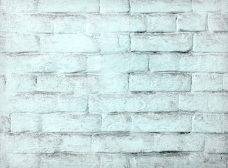 White grunge background of old brick wall texture with delicate vignetting.