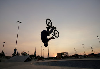 A man performs tricks on a bicycle in Ciudad Juarez