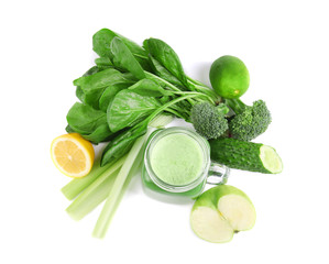Mason jar of green healthy juice with vegetables and fruits on white background