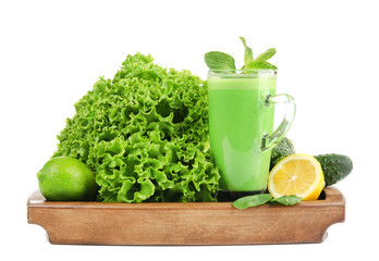 Glass of green healthy juice with ingredients on white background