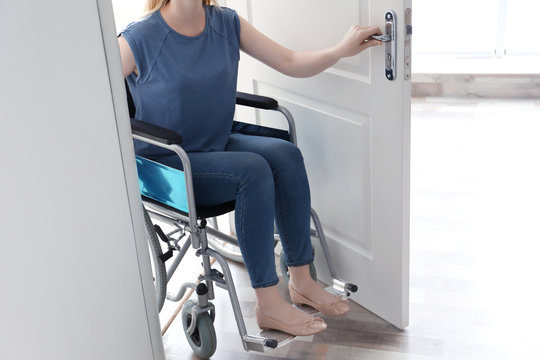 Young woman in wheelchair at home