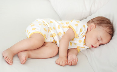 Cute baby sleeping on bed