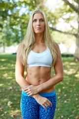 Athletic woman exercising outdoors