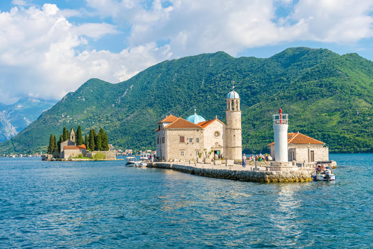 MONTENEGRO - JUNE 04/2017. Tourists sailed on a yacht to the island of Gospa od Skrpela in the Boka Bay of Kotor.