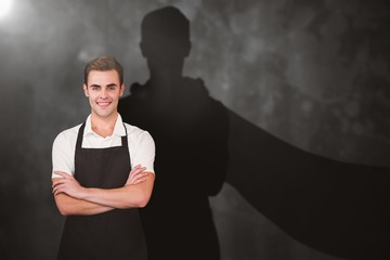 Composite image of portrait of young man with arms crossed