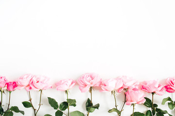 Pink roses on white background. Flat lay, top view. Valentine's background. Floral pattern. Pattern of flowers. Blog hero image.