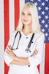 doctor with stethoscope on a usa flag background
