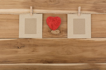 picture frame paper and red heart pace on wood background,Love valentine vintage.