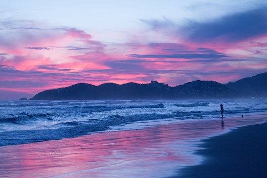 Cloudy Blue & Pink Sunset over Misty Acapulco Beach