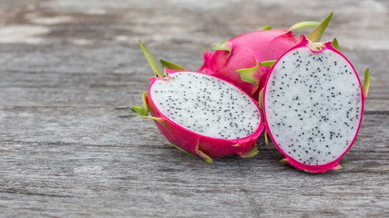 Dragon fruit on old wood background