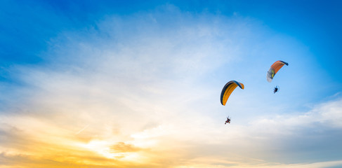 Wall Murals Sky sports sunset sky background with paramotor