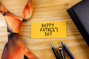 Tie,wallet,pen and yellow board. Happy Father's Day Concept