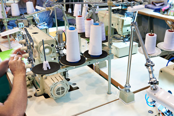 Sewing workshop with threads and electric machines