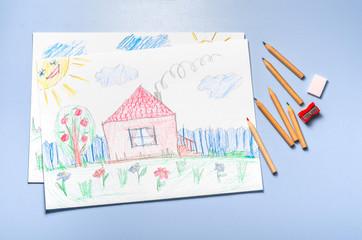 Children's drawing and color pencils top view