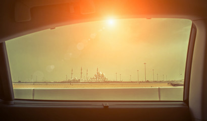 View from car window on the Mosque of Sheikh Zayed in Abu Dhabi,