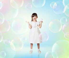 Little girl with big soap bubbles.