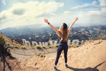 Young woman at the top of Hollywood, Los Angeles, California