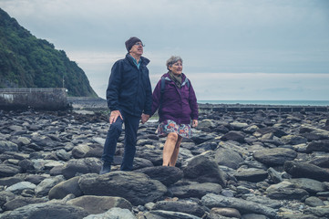 Senior couple on the beach in autumn