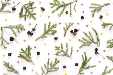 Christmas background. Fir branches isolated on white background. Christmas tree. Christmas toys, snow, fir, rowan in frost, top view. Composition of fir branches, pattern. Christmas frame.
