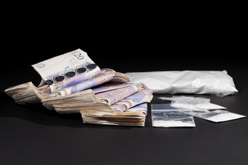 UK drug money. Cocaine and cash. Money from grug dealing.