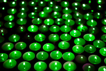 Green energy. Save the planet. Soft background image of candles burning at a vigil.