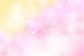 音符とピンクのボケ背景